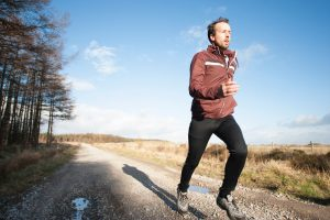man running in sunshine