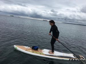 Esther nagle on a paddleboard on the sea at Famouth, cornwall