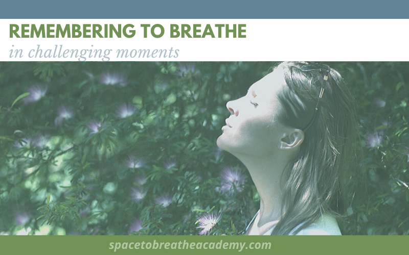 remembering to breathe woman taking a deep breath in front of flower bush